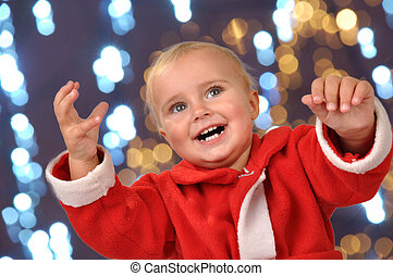 happy Christmas baby with hands raised