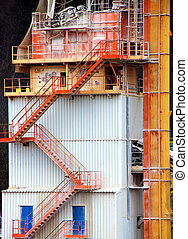 Tower on gravel pit for transporting a gravel