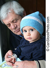 baby and his grand father - baby boy and his grand father,...