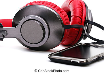 Fashion headphones and player on a white background. -...