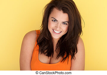 Smiling Joyful Model with dishevelled long brunette hair on...