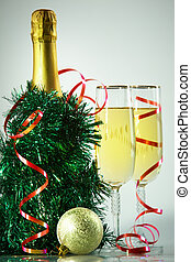 Celebration objects - Two champagne flutes with green...