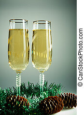 Christmas still-life - Two champagne flutes with firtree...