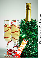 Christmas composition - Two champagne flutes with green...