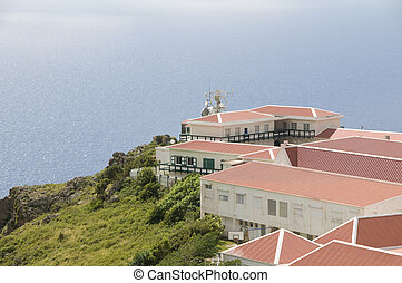 """village typical house business school architecture on cliff over Caribbean Sea on """"The Road"""" Saba Dutch Netherlands  Antilles"""