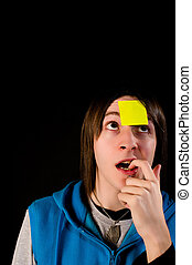Forgetting - Forgetful guy with a sticky note on his...