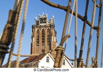 Dordrecht cathedral and rigging of an old galleon ship -...