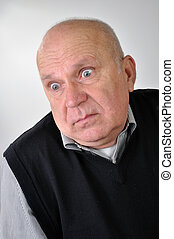 senior man with puzzled expression - portrait of a senior...