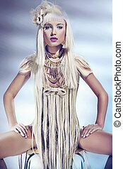 Blond beauty wearing dress made by hair