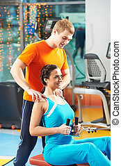 woman with trainer at training simulator - woman with...