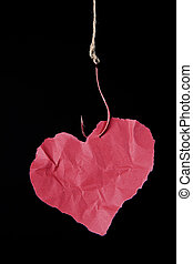 addiction - hanging paper heart ilustrating damaging effect...