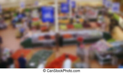 Supermarket. Timelapse. Defocused. - Shoppers in the fruit...