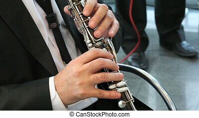 playing jazz music - man playing on the woodwind instrument...