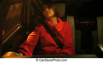 young women on passenger seat into moving car