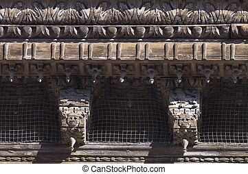 eaves - closeup of a wooden eaves in the palace of the...