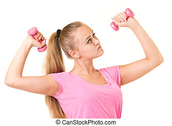 girl with free weights in gym - Beautiful smiling girl with...