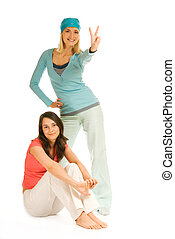 Two teenage girls isolated on white background