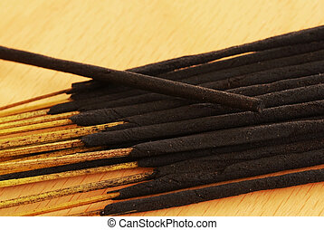 Incense sticks - lot of incense sticks unlit on brown table
