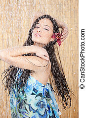 Sensual woman under the shower - Sensual woman with orchid...