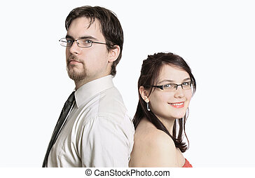 Cute young couple happy together standing back to back on a...