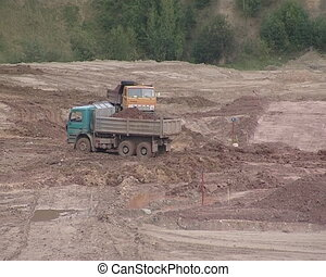 Trucks loaded with earth at the construction site.