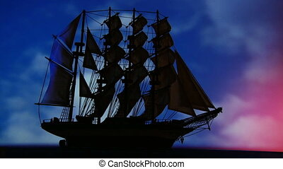 Large old sailing ship travels at night Beautiful sky