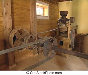 Old mill equipment. Grain milling. Ancient Industry.