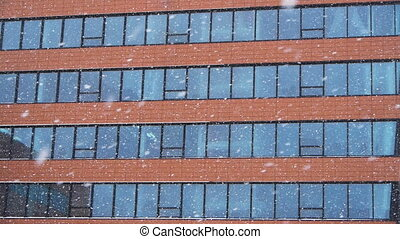 Snowfall against an office building
