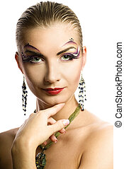 Beautiful young woman with creative make-up on her face