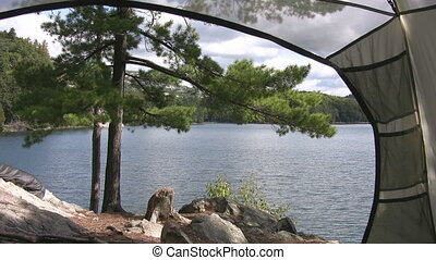 View from the tent. Two shots. - A panoramic view of a lake...
