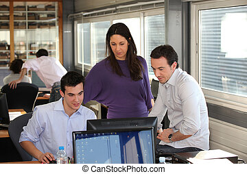 Group of collaborators in front of computer