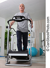Middle-aged man on treadmill at home