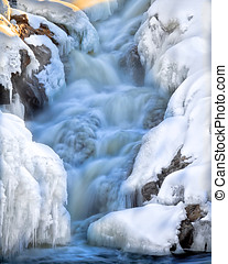 Winter Waterfall - Wilderness waterfall covered with snow...