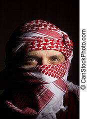 Man in a Keffiyeh - Close-up photograph of a man in a red...