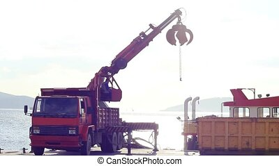 Crane truck - Port mobile crane lifting up the bucket Bucket...