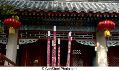 Taoist statues Buddha in door,Burning incense in Incense...
