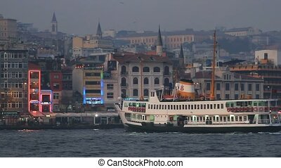 Istanbul, Karakoy at night - Ferry boat sails to Karakoy...