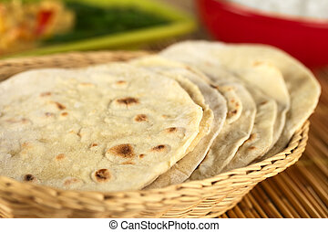 Indian flatbread called chapati in basket (Selective Focus,...