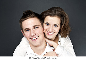 young couple togheter on black background
