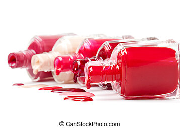 Colorful nailpolish in a row isolated over white -...