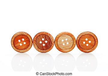 Wooden buttons on a white background