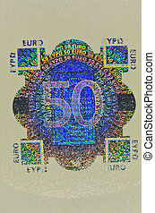 hologram protection on 50 euro banknote - macro shot of...