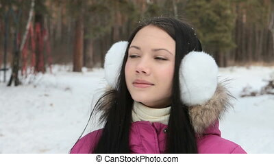 Girl breathing out in wintry air - Smiling girl breathing...