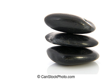 Black hotstones - Stack black hotstones isolated over white...