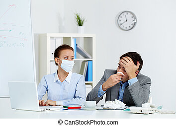 Working during illness - Image of sick businessman with...