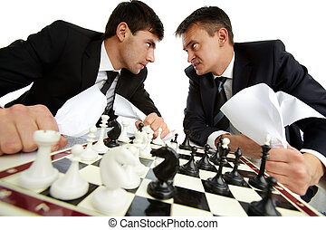 Aggression - Two men with papers looking at each other...
