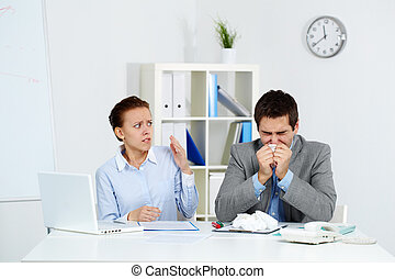 Anxious about catching flu - Image of sick businessman...