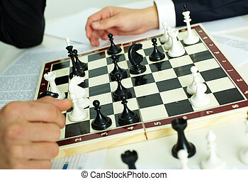 Chess play - Image of chess figures on chessboard with human...