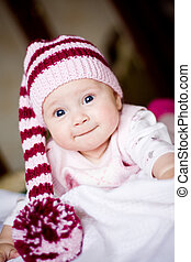 cute baby in a hat with pompom - cute baby in a striped...