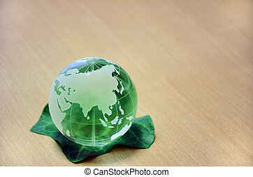 Green glass globe (Eurasian Continent). The green earth with...